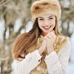 Portrait of a beautiful woman in winter