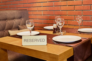 Served table in cafe with walls of red bricks