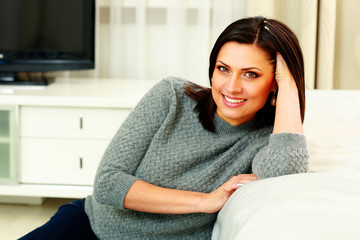 Portrait of a middle-aged smiling woman at home