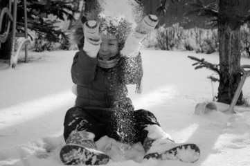 a child plays in the snow