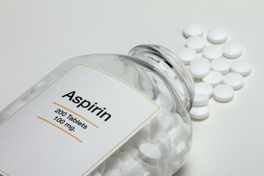 Aspirin bottle fallen over with pills, horizontal