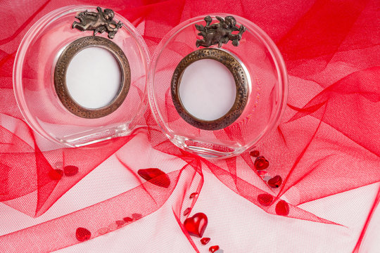 love card with glass photo frame on a red fabric