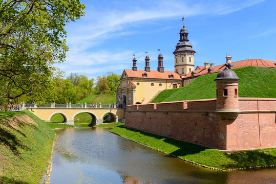 View on medieval castle Nesvizh and moat with water. Belarus