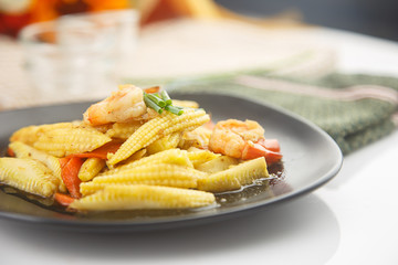 stir fried baby corn and shrimp on dish