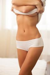 Woman undressing.