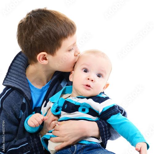 Portrait of little boy kiss his cute baby brother over white portrait of little boy kiss his cute baby brother over white thecheapjerseys Images