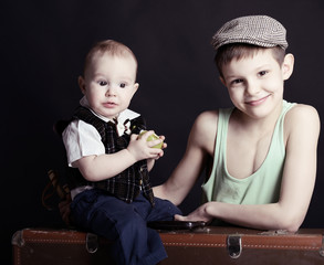 vintage art portrait of little boy with his baby brother leaning