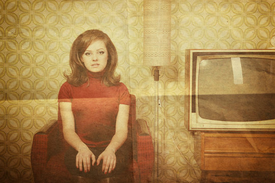 art portrait of young woman looking out at camera in room with v