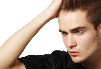 Portrait of handsome young man, sexy guy touching his hair over