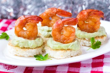 Shrimp on toast with guacamole sauce avocado, Christmas tasty