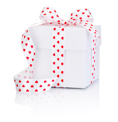 White box tied satin ribbon with heart symbol bow Isolated on wh