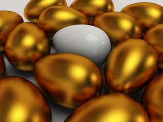 Unique white egg among gold eggs