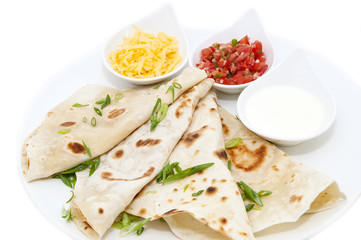 Mexican food dishes at the restaurant on a white background