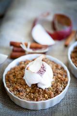 Apple crumble dessert with cinnamon and vanilla ice -cream on wo