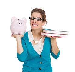 Confused, stressed woman student holding piggy bank, books