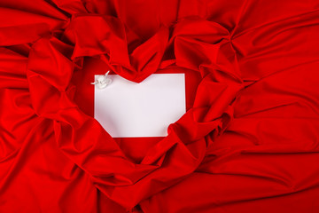 love card with angel on a red fabric