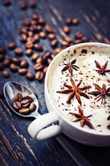 Cup of aromatic coffee and coffee beanes/coffee background
