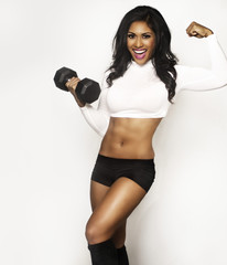 Beautiful smiling fitness woman holding weight