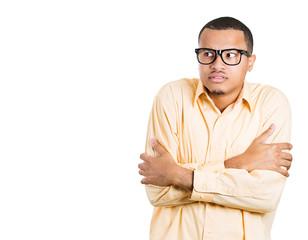Anxious young man avoiding eye contact