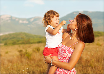 Wall Mural - Mother and daughter in the mountains