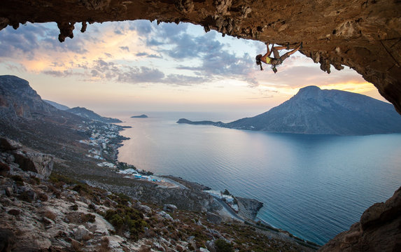Female rock climber at sunset. Kalymnos Island, Greece.