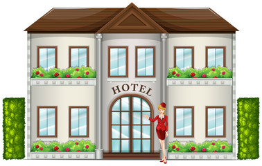 A hotel attendant standing in front of the hotel