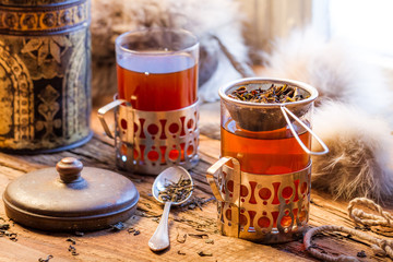 Fototapete - Hot tea brewed in the old style