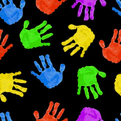 Seamless dark background with bright colored handprints