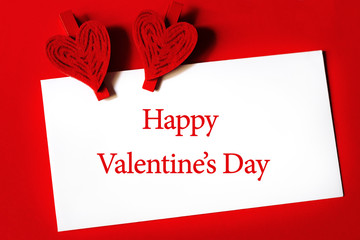 Happy Valentine's Day - paper sheet with heart shaped clips