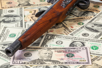 Old gun and money