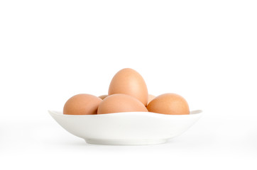 eggs in white dish isolate