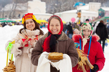 Mature woman with pancake during  Shrovetide