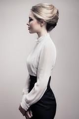 Wall Mural - Beautiful Blonde Woman. Retro Fashion Image.