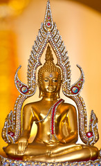 Ancient image of buddha with gold background