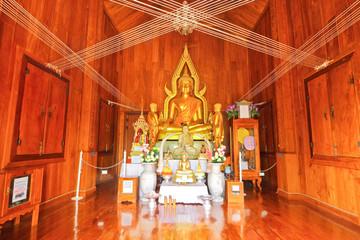 Inside of Buddhist church made from golden teak wood