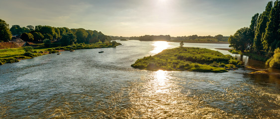 Fototapete - View of the Loire at sunset in Amboise, France
