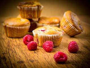 Wall Mural - Raspberry muffins on wooden background