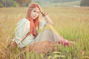 Hippie girl at golden field