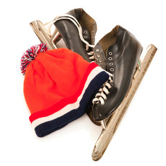 Used male ice skates and dutch hat