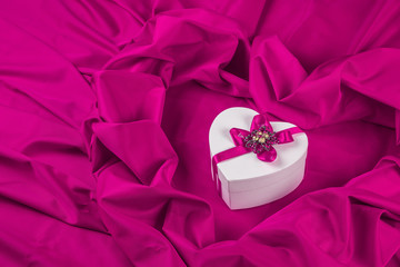love card with heart on a purple fabric