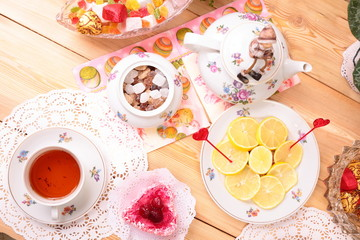 Warm cup of tea and sweets