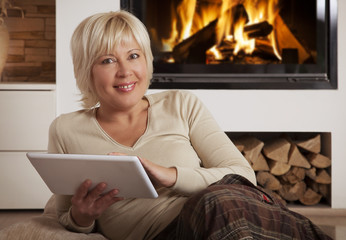 Adult woman using digital tablet computer