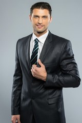 Well-dressed handsome man in black suit and tie