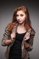 Young girl in a leather jacket represents model