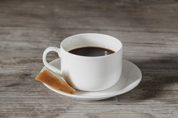 Coffee cup whit cheese center on wooden table
