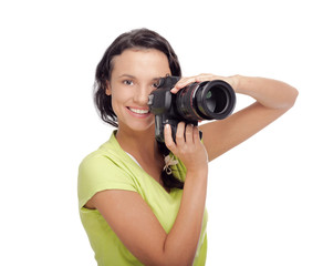 Beautiful young woman with camera.Isolated on white background