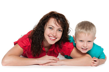 Happy mother with her son lie on the floor