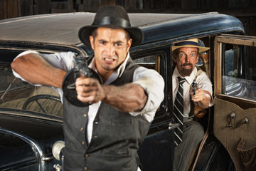 Angry 1920s Era Gangsters with Guns