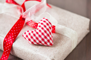 Homemade red heart and gift with red ribbon