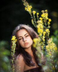 Portrait of a young woman in flowers